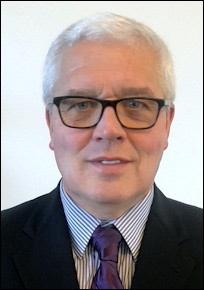 Simon J George